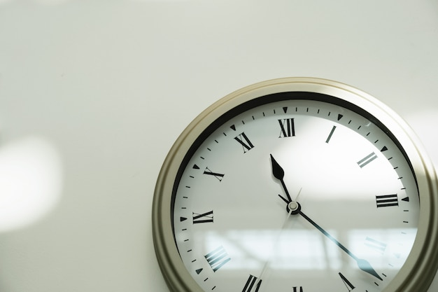 Classic clock on a white wall