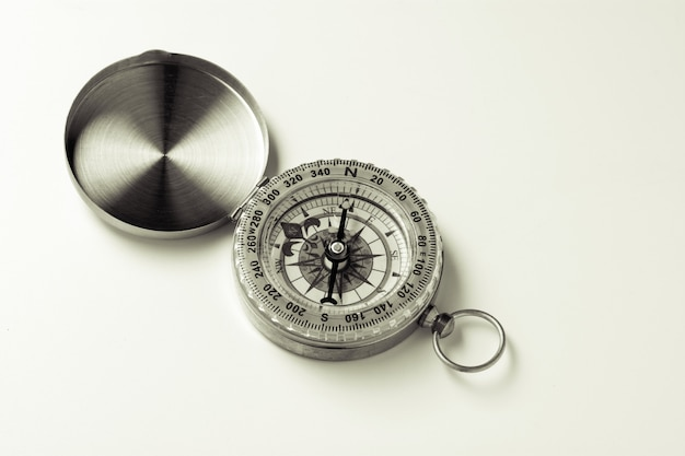 Classic compass on white background. - vintage style
