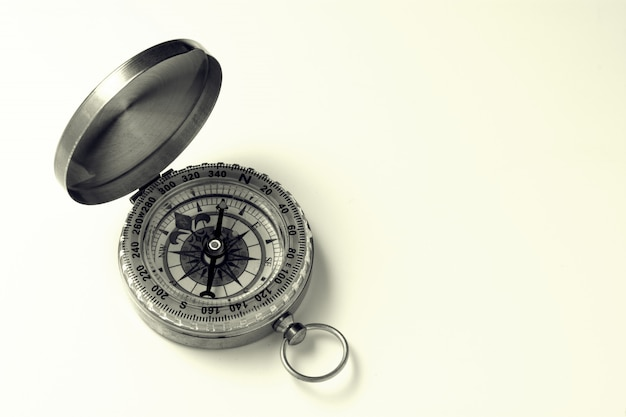 Classic compass on white background