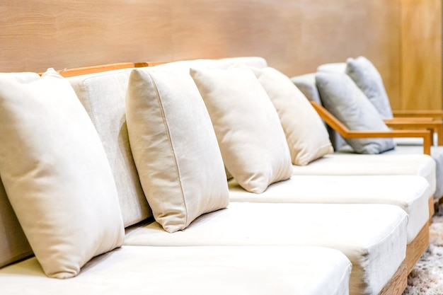Classic creamy and wooden sofa in bangkok tourist lounge for welcome vip person with luxury capet.