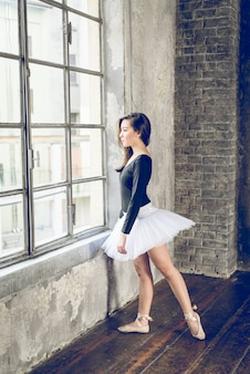 Classic dancer looking at window