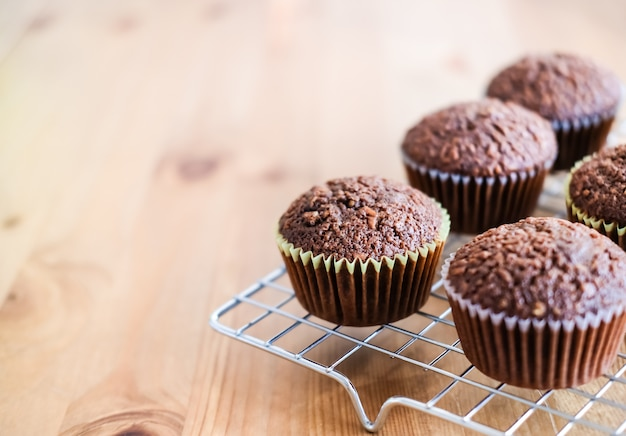 Classic dark chocolate cupcakes on silver baking rack