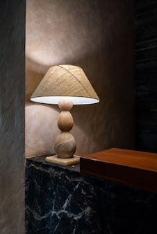 Classic desk lamp in the dark room