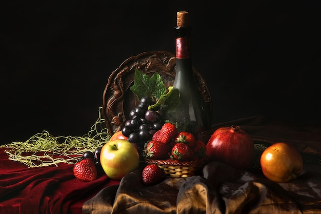 Classic dutch still life with dusty bottle of wine and fruits on a dark