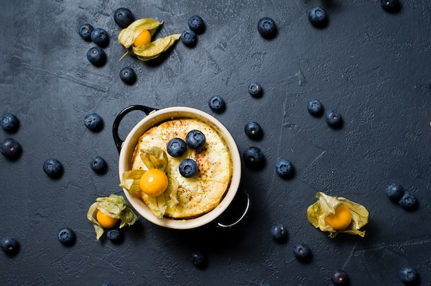 Classic english rice pudding. blueberries and physalis.