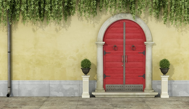 Classic facade with red doorway and stone portal