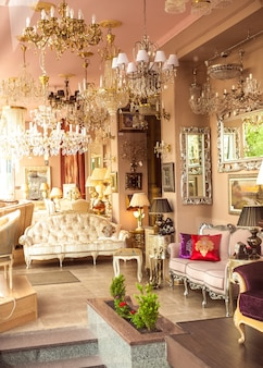 Of classic french interior with mirrors, lamps and sofas