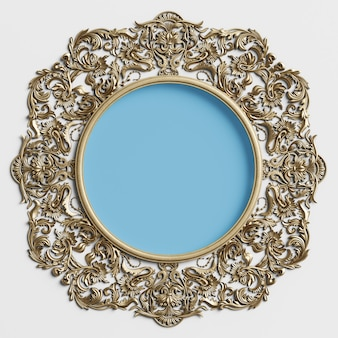Classic golden round frame with ornament decor and blue circle in center on the white wall