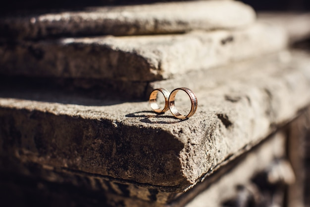 Classic golden wedding rings on a stone