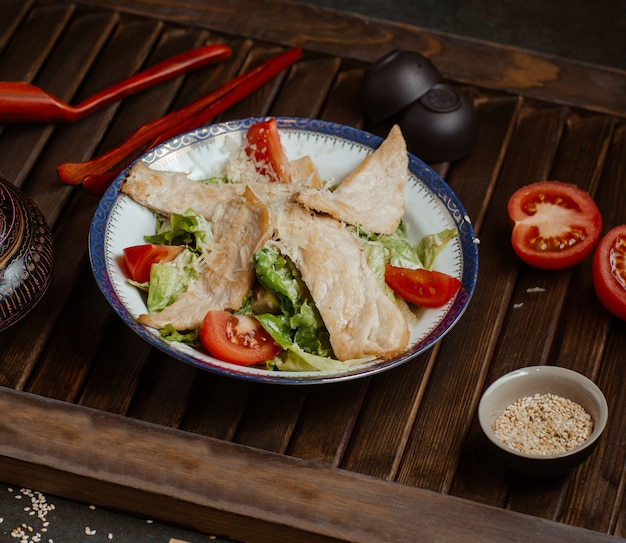 Classic greek caesar with fish filled and vegetables