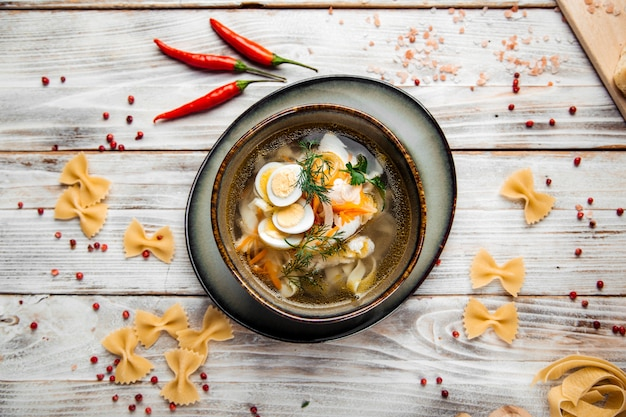 Classic homemade and quail eggs noodles in a bowl
