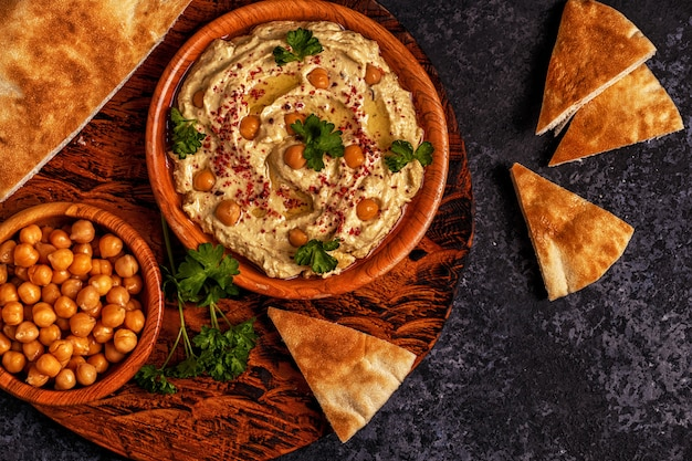 Classic hummus on the plate top view