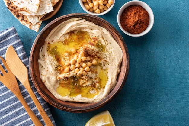 Classic hummus with chickpeas, paprika, olive oil, and oriental spices