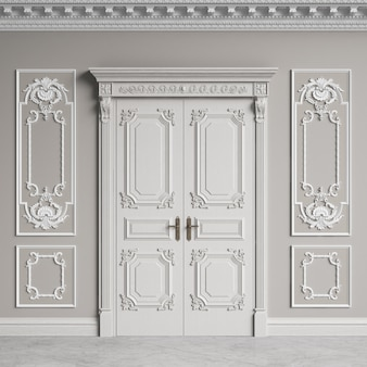 コーニスとモールディングを備えたクラシックな内壁。装飾が施されたドア