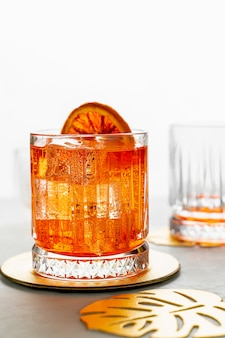 Classic italian aperol spritz cocktail. closeup view, portrait orientation