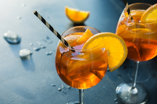 Classic italian aperol spritz cocktail on dark.