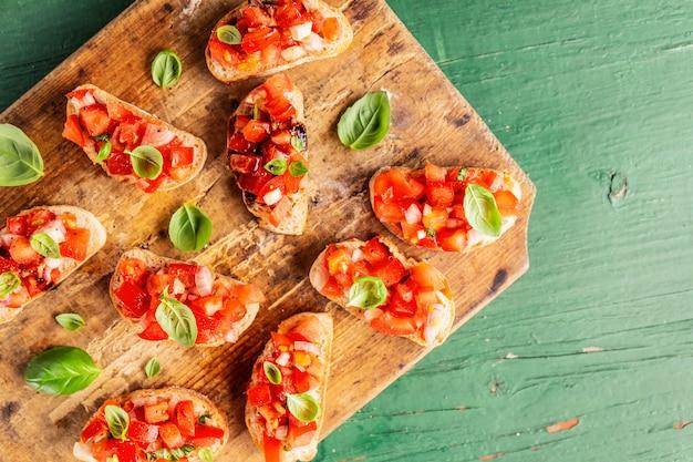Classic italian bruschetta served on wooden board