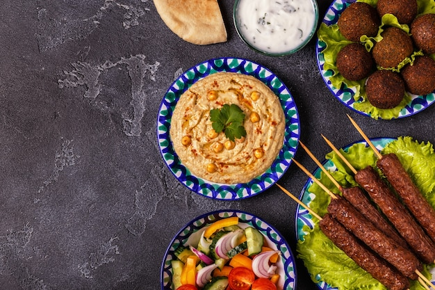 Classic kebabs, falafel and hummus on the plates