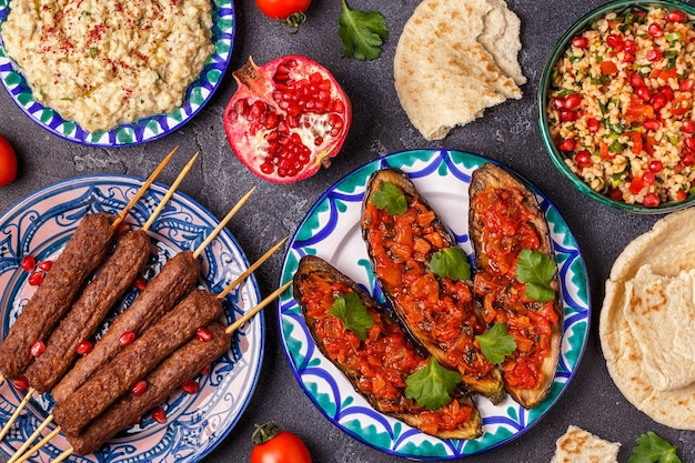 Classic kebabs, tabbouleh salad, baba ganush and baked eggplant with sauce