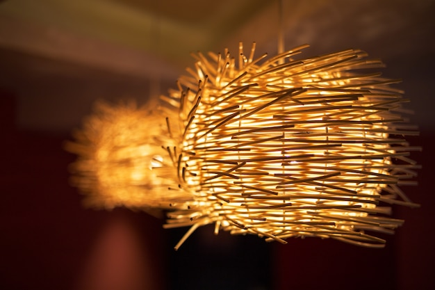 Classic lamp made from farmer's bamboo hat hanging on ceiling