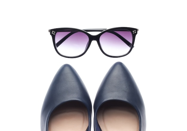 Classic leather high heel shoes and sunglasses isolated on white background. women's accessories