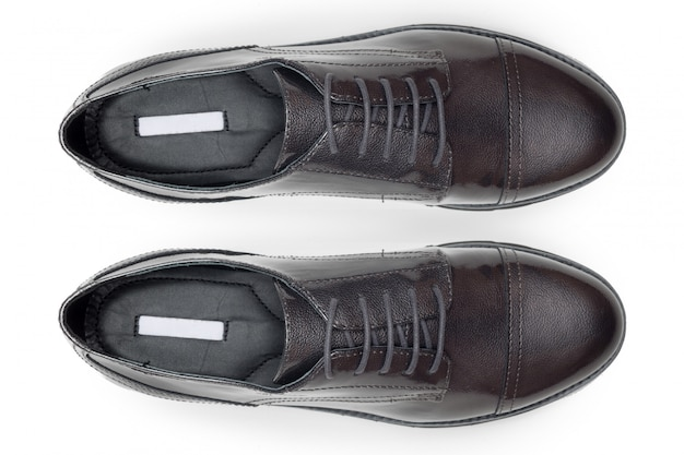 Classic male leather shoes isolated on a white, top view.