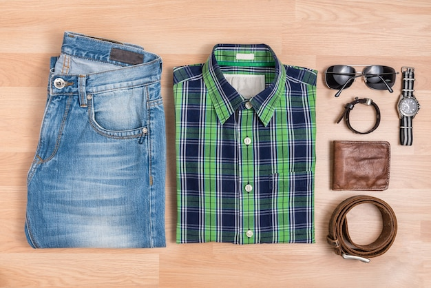 Classic men casual outfits with accessories on table