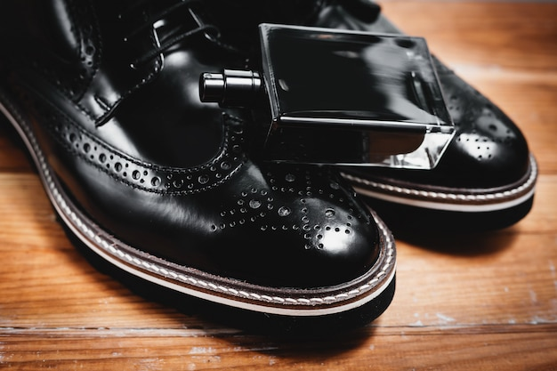 Classic men's accessories. shoes with perfume
