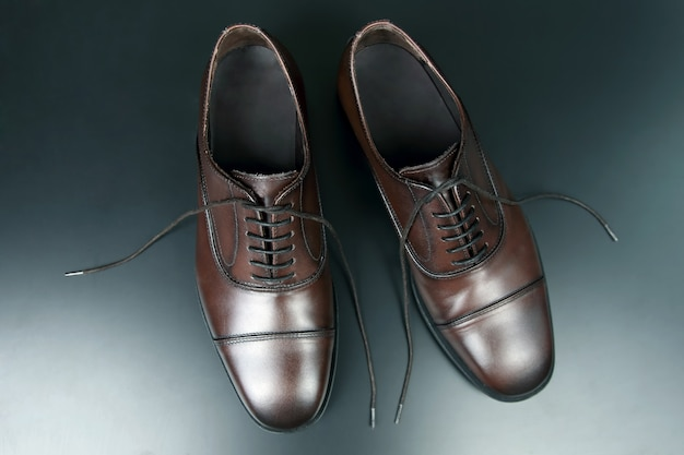 Classic men's brown oxford shoes on dark