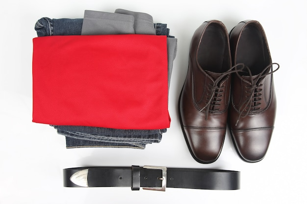 Classic men's brown shoes, belt and clothes on white background