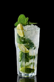 Classic mojito cocktail isolated on black surface