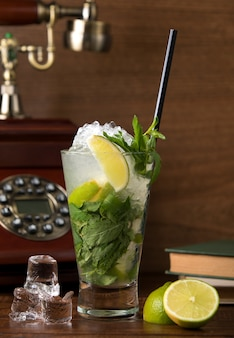 Classic mojito with lemon and mint leaves