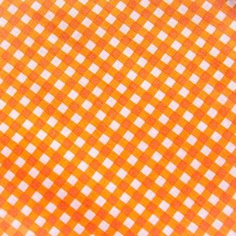 クラシックなオレンジ色の格子縞の生地またはテーブルクロスの壁