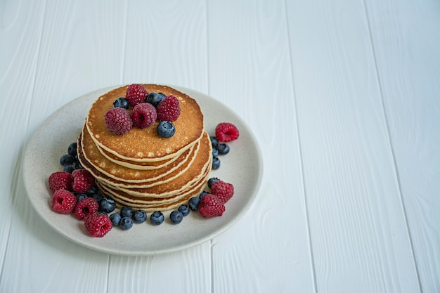 Classic  pancakes with fresh berry on a blue wooden table. pancakes with fruit.