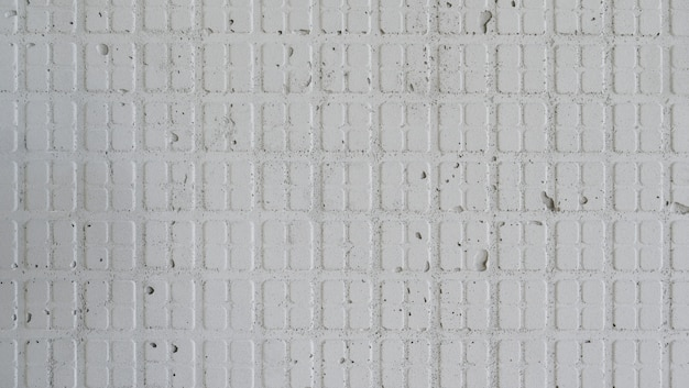 Classic patterned cement wall texture for background.