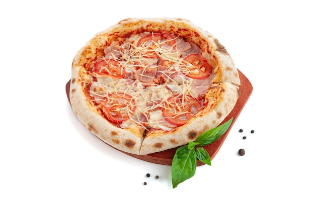 Classic pizza with tomatoes, ham and cheese. on a wooden tray. decorated with basil and spices. white background. isolated.