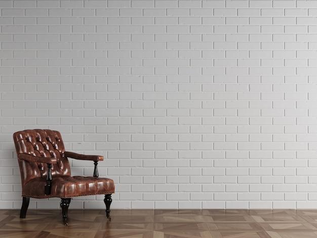 白いレンガの壁の前に立っているクラシックな赤茶色の革張りのアームチェア