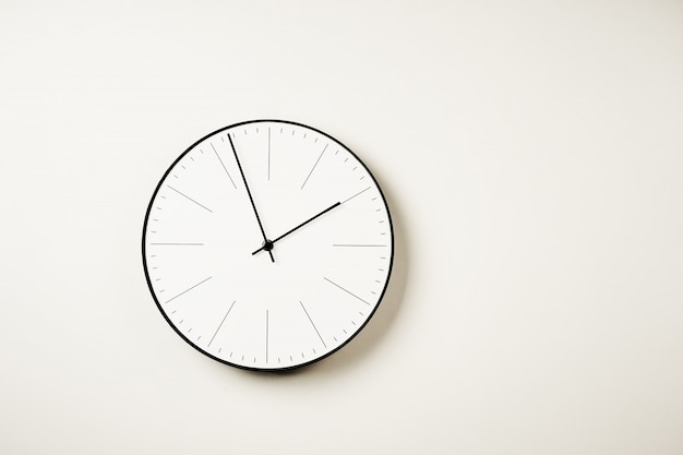 Classic round wall clock on white with copy space