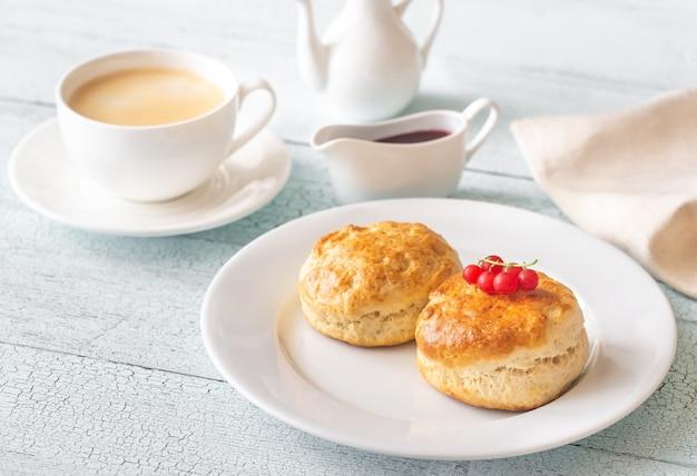 Classic scones with cream and berry jam