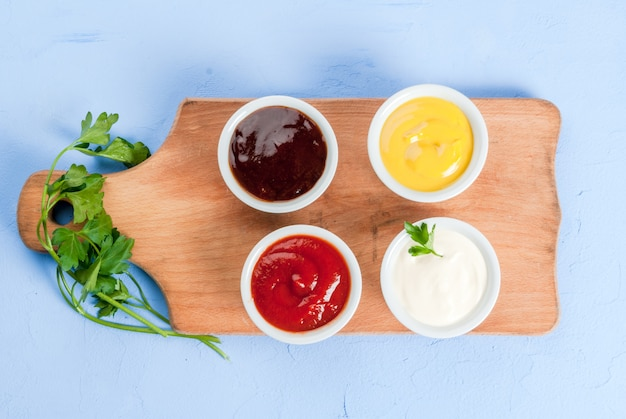 Classic set of sauces in white saucers