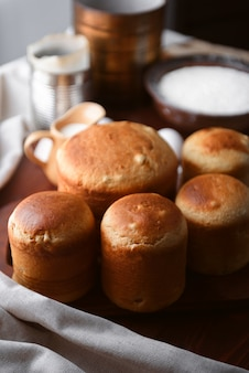 Classic slavic easter cakes with ingredients in a rustic style