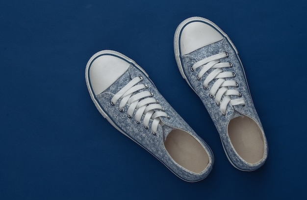 Classic sneakers on a classic blue