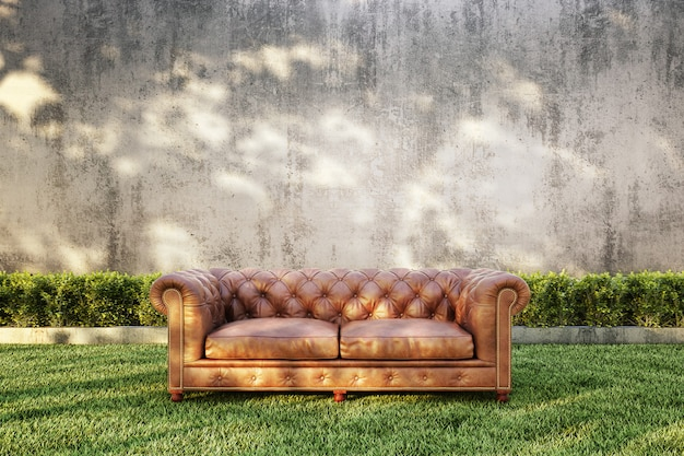 Classic sofa with bush and bare concrete wall background.