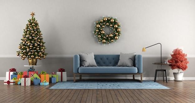 カラフルなギフトと青いソファの3dレンダリングとクリスマスツリーのあるクラシックなスタイルのリビングルーム