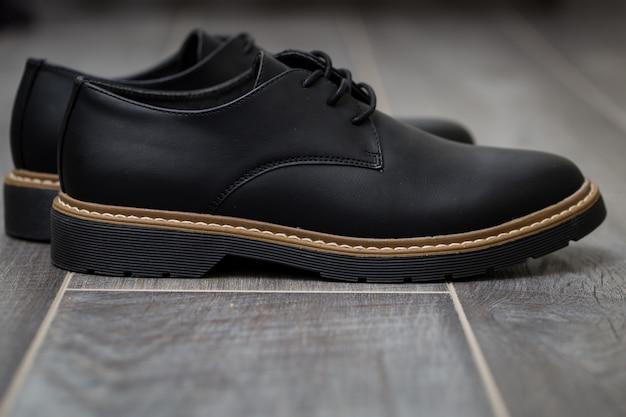 Classic stylish men's shoes closeup on gray