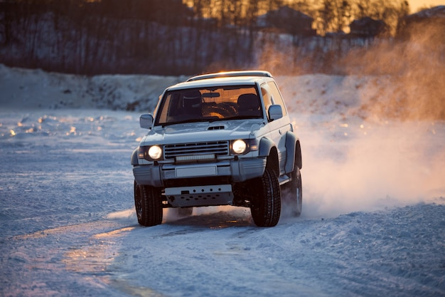 Classic suv rally race at frozen river in winter