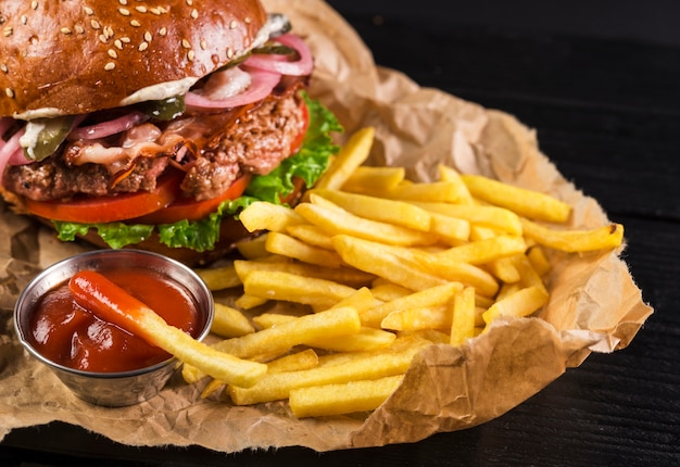 Classic take away burger with fries and ketchup