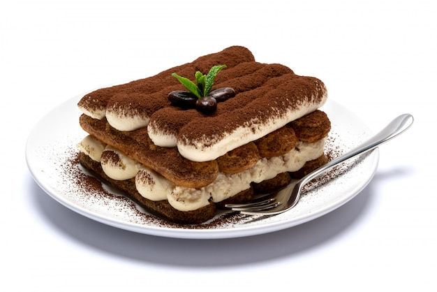 Classic tiramisu dessert on ceramic plate isolated on white surface with clipping path