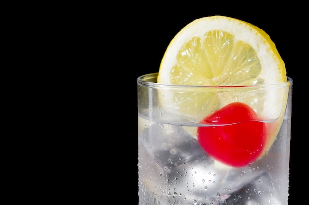 Classic tom collins cocktail on black