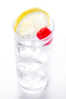 Classic tom collins cocktail isolated on white surface